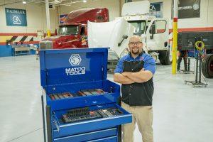 Western Tech Diesel Mechanics Student next to Matco Tools
